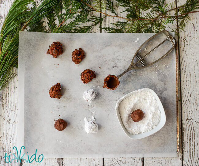 Gluten Free chocolate crinkle cookie dough scooped out on parchment paper