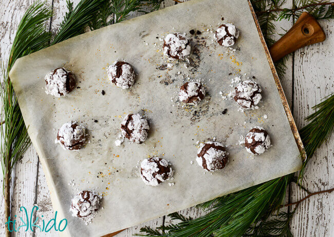 Baked Gluten Free chocolate crinkle cookies on a cookie sheet