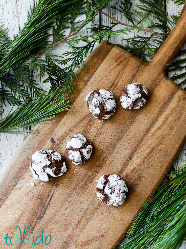 Gluten Free chocolate crinkle cookies on a wooden cutting board