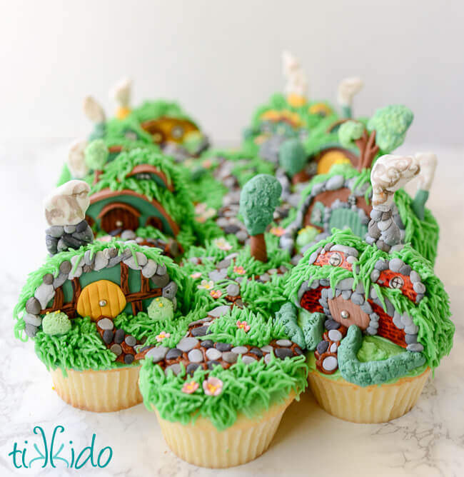 Collection of hobbit hole cupcakes clustered together to form the Shire.