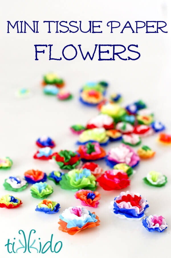 Colorful Mexican style miniature tissue paper flowers on a white background.