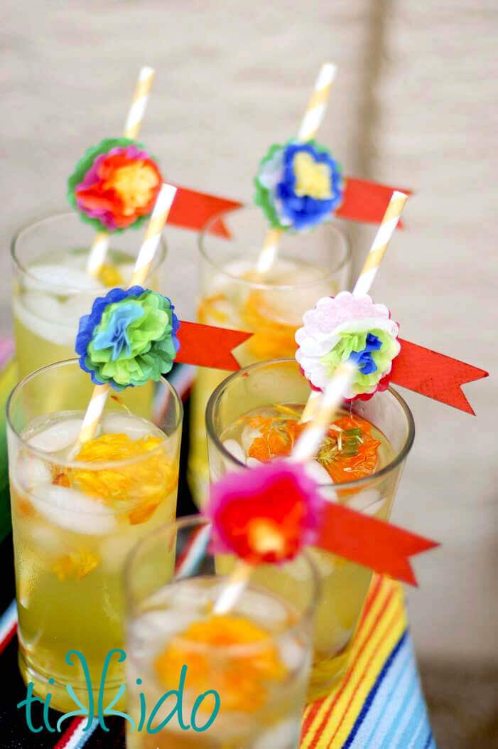 Colorful Mexican style miniature tissue paper flowers decorating straws