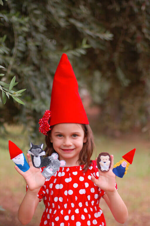Little girl wearing a gnome hat and a red polka dot dress ccbf99d9c51