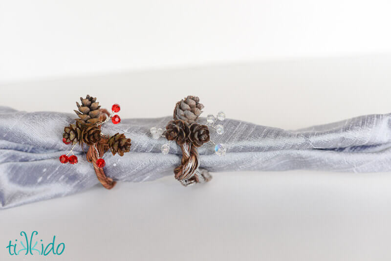 Real pinecone napkin rings made with pine cones, Swarovski crystals, and floral wire.