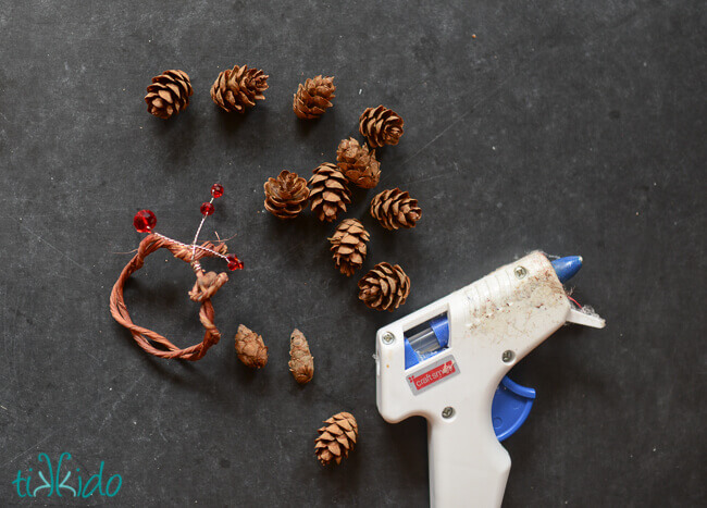 Making a pinecone napkin ring with a glue gun