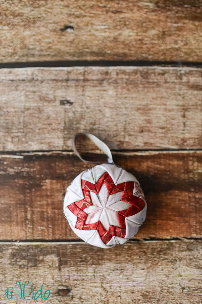 One no sew quilted star Christmas ornament in red, pink, and white colors.