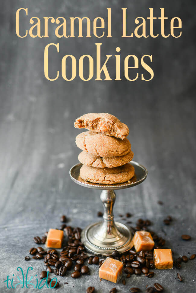 Coffee flavored cookies filled with caramel stacked on a small stand, surrounded by coffee beans and caramel candies.