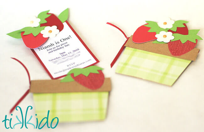 Strawberry Picnic Birthday invitations that look like baskets of strawberries.