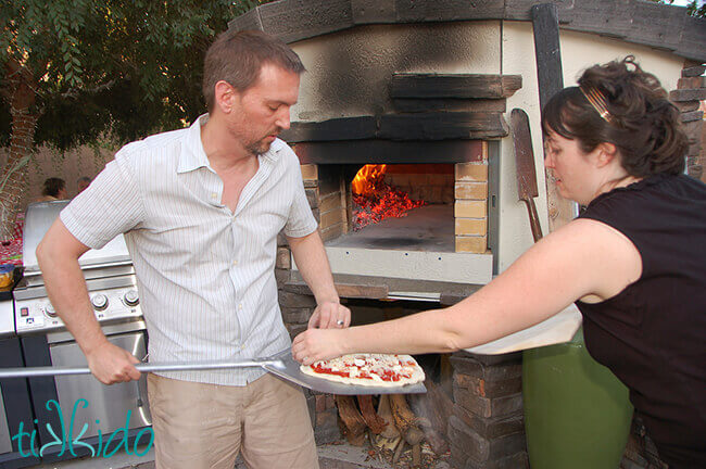 Pizza being made in a wood fired pizza oven.