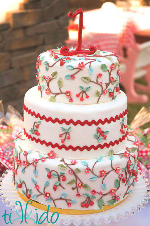 Calico fabric inspired birthday cake at the Strawberry Picnic birthday party.