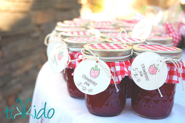 Homemade strawberry jam favors at the Strawberry Picnic birthday.