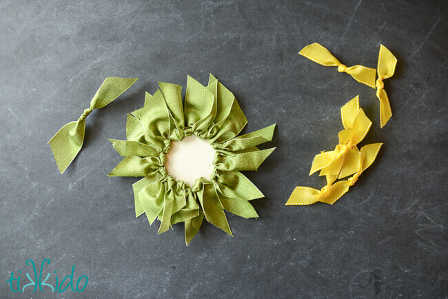 Leaves and petals of the ribbon sunflower being assembled.