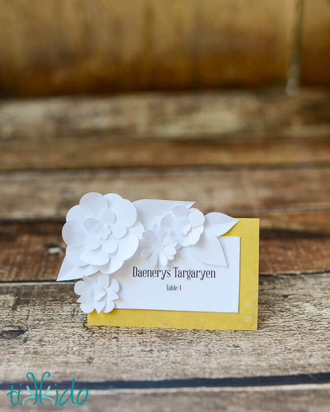 DIY wedding seating card decorated with paper flowers