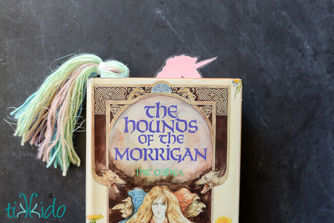 Unicorn bookmark peeking out of the top of The Hounds of the Morrigan book.